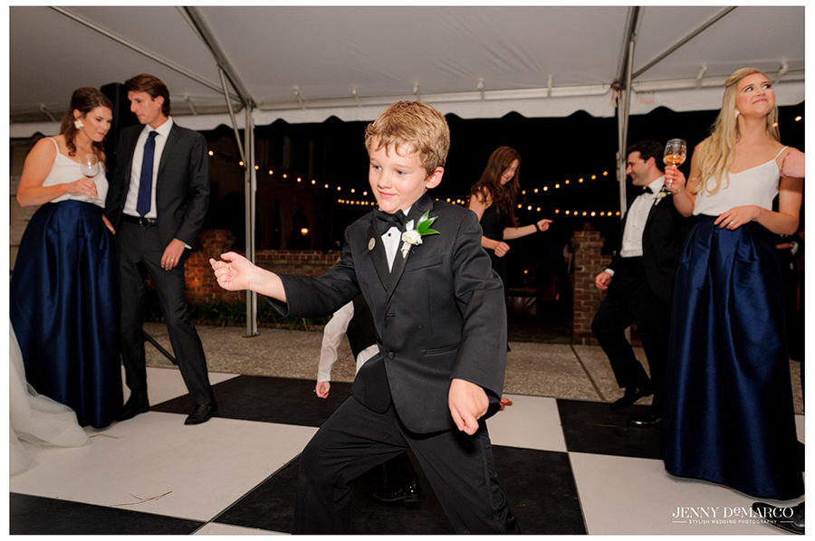 Ring bearer is relieved to be showing off his dance moves at the reception.