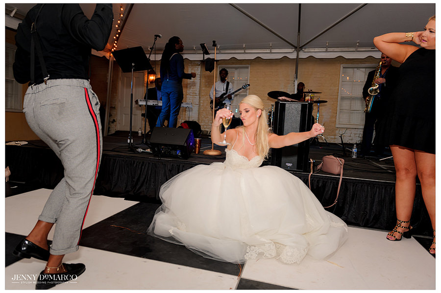 Bride drops it low in her ball gown wedding dress.