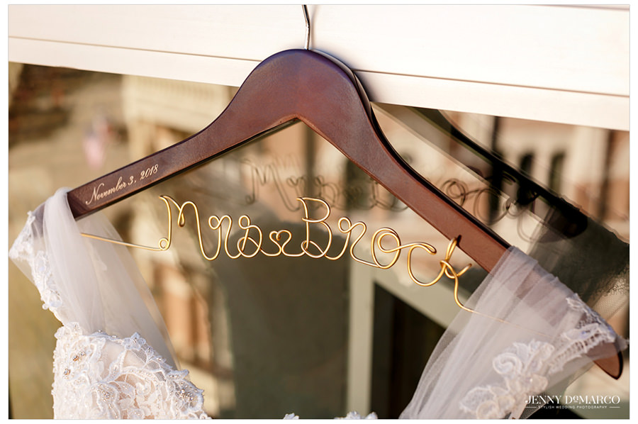 A decorative hanger holds the bride's gown.