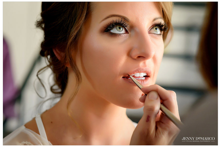 The bride gets her last makeup touches.