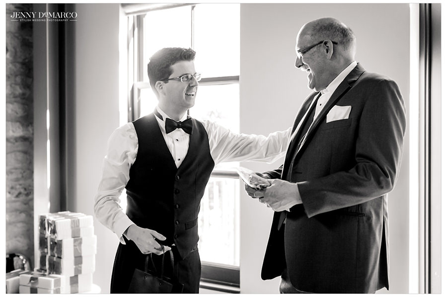 Groom shares a moment with his father as they get ready together.