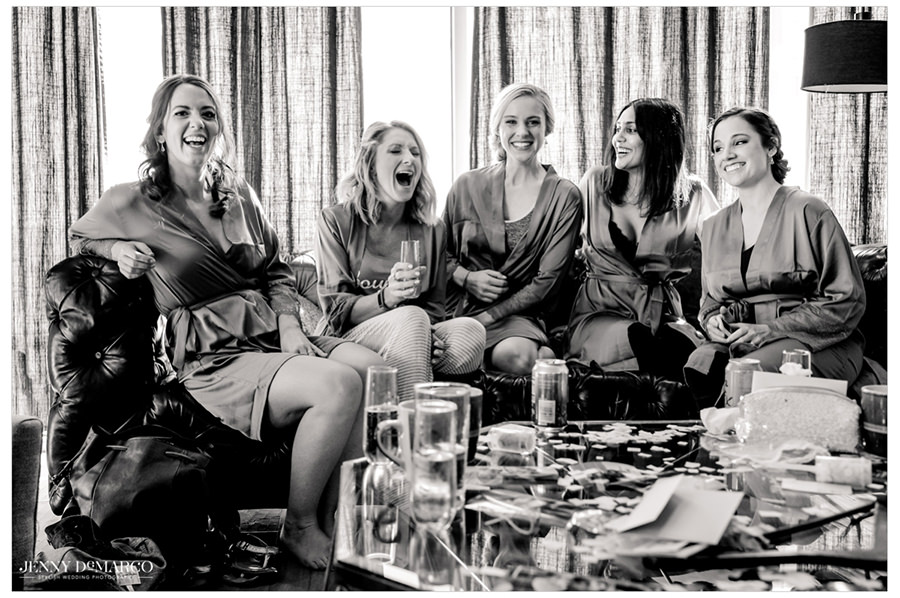 Bridesmaids gather around and spend time together before putting on their dresses.