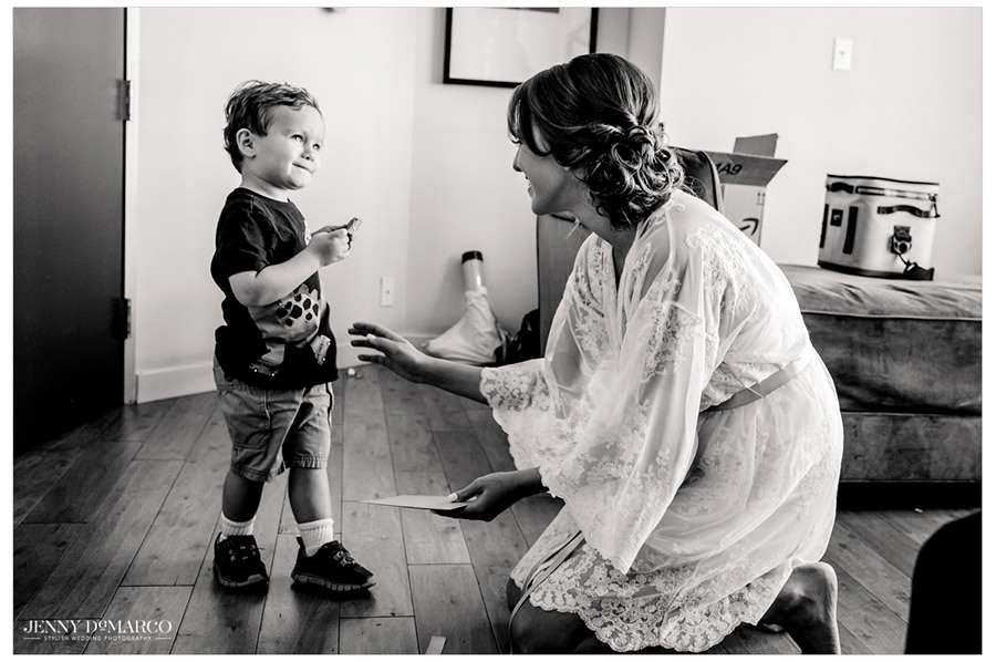 Bride shares a moment with a sweet little boy.