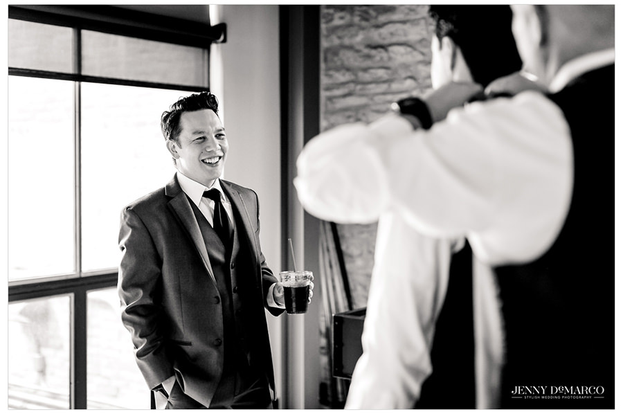The groomsmen share in helloing each other get ready.