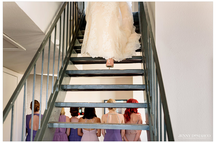 The bride descends the stairs ready to reveal her look.
