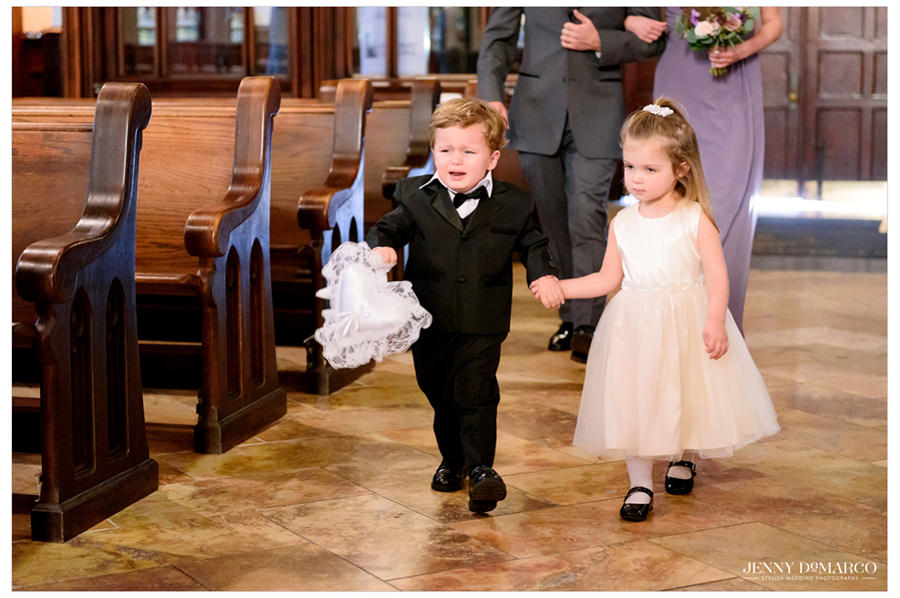 The wedding commences with the ring bearer and flower girl.