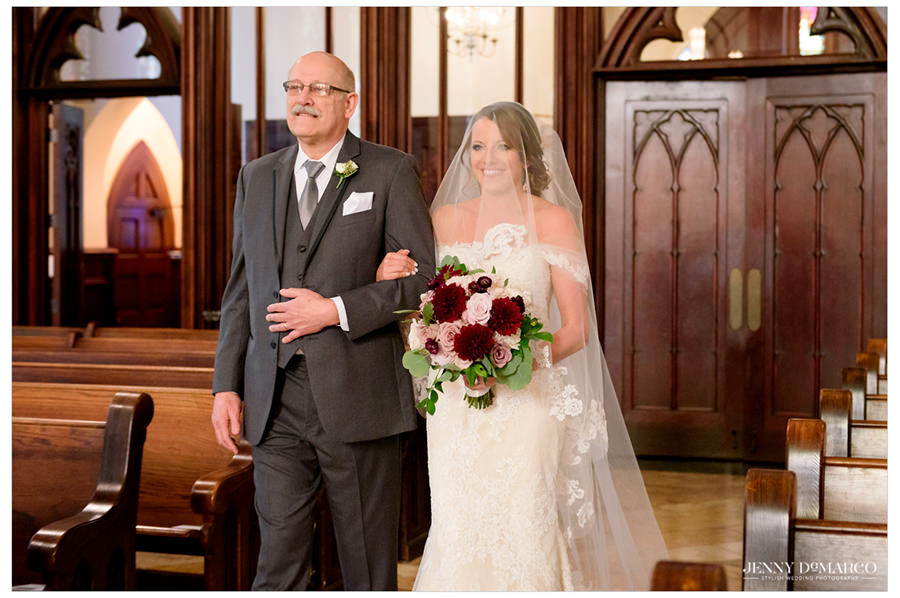 Bride is walked down the aisle by her father.