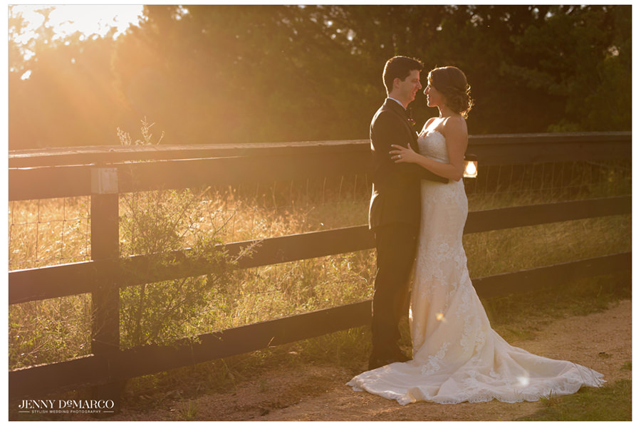The warm glow of the sun illuminates the newly weds.
