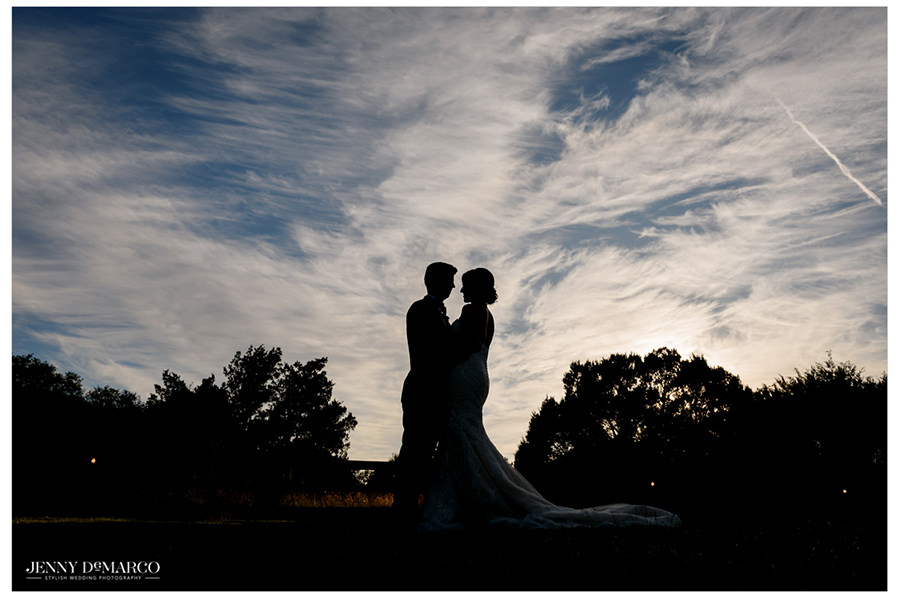A silhouette photo of the couple embracing one another.