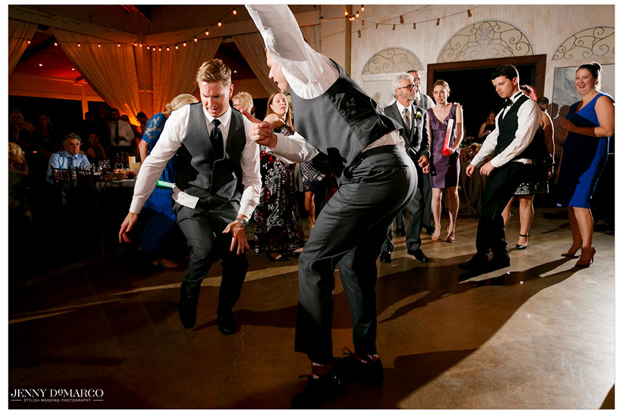 Groomsmen bring the dance floor to life.