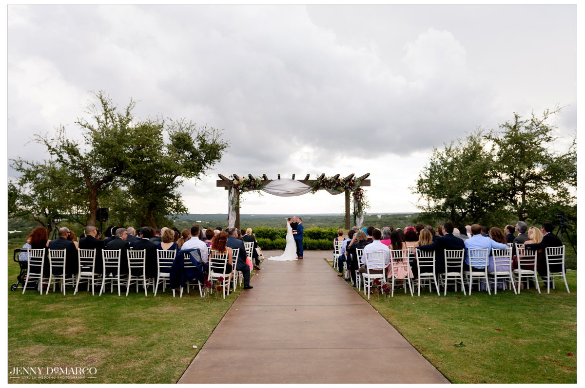 A wide angle shot of the outdoor wedding ceremony.