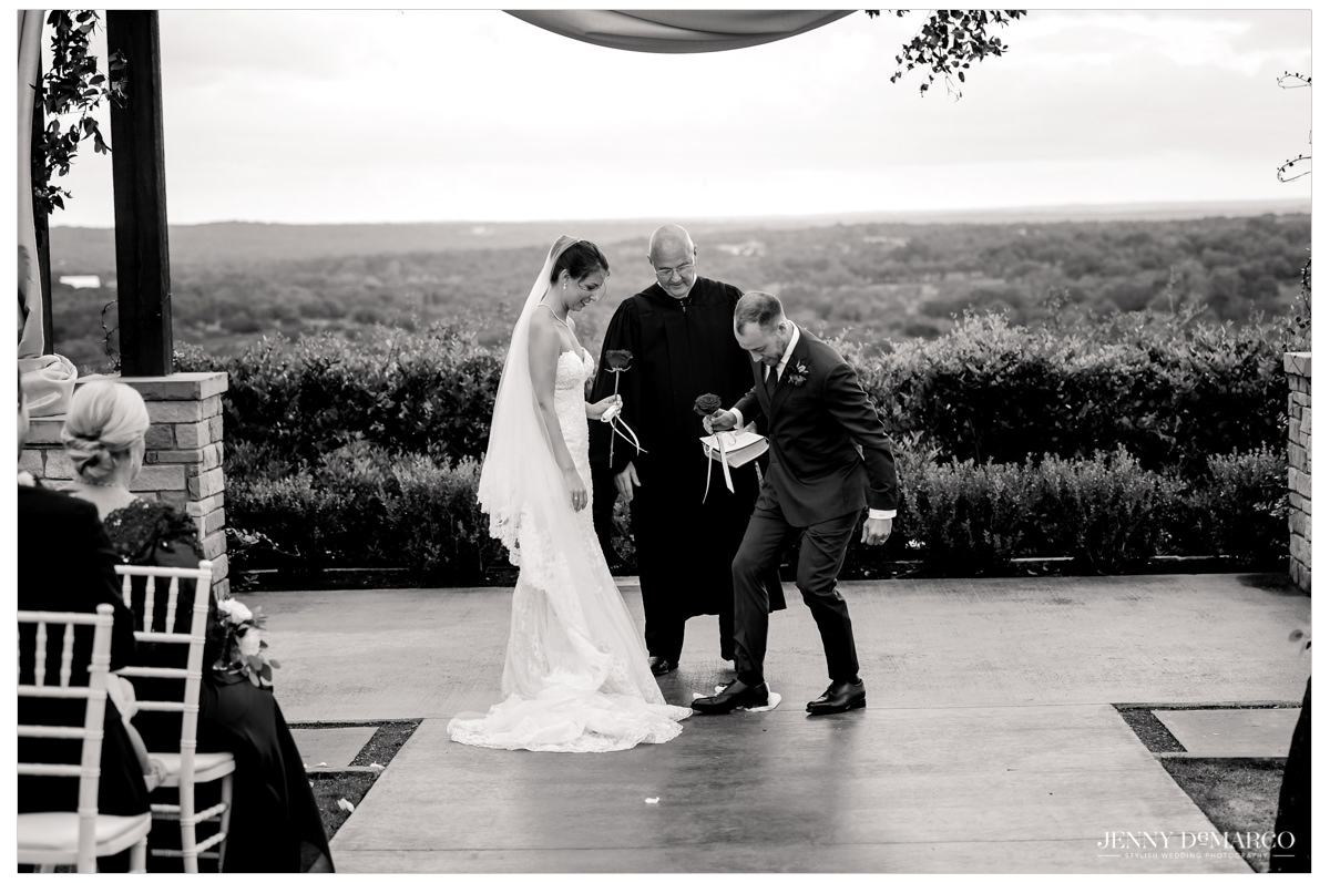 The couple crushes the piece of glass as part of the tradition.
