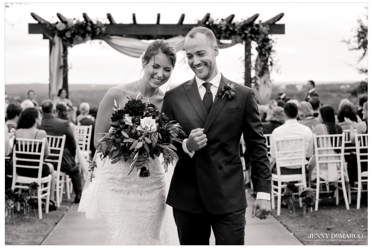 Bride and groom share a sweet moment as they walk down the aisle.