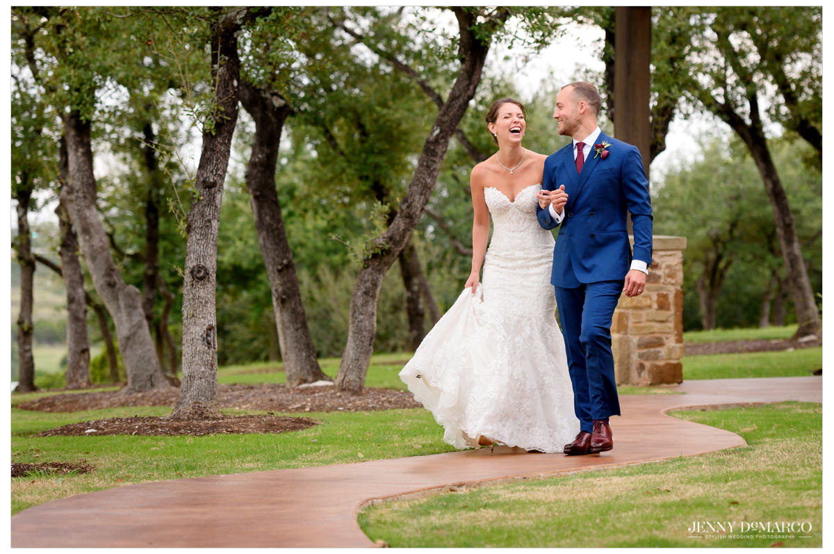 The couple walks along the property after the ceremony.