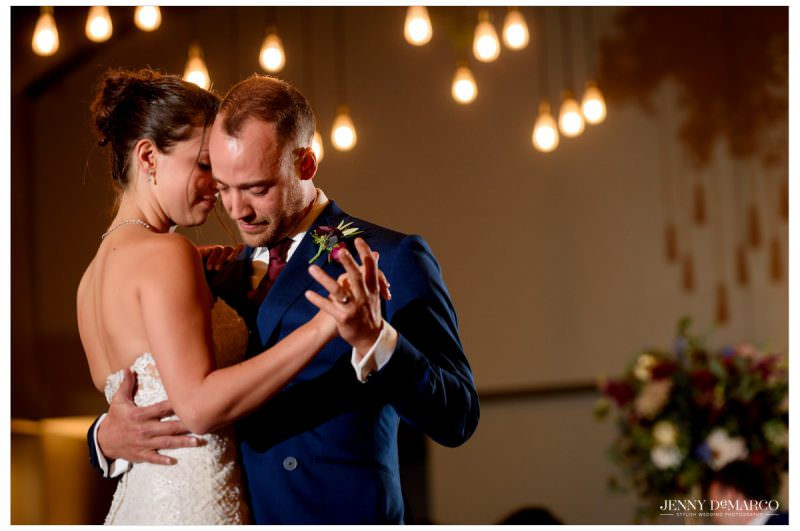 The couple has their first dance together.