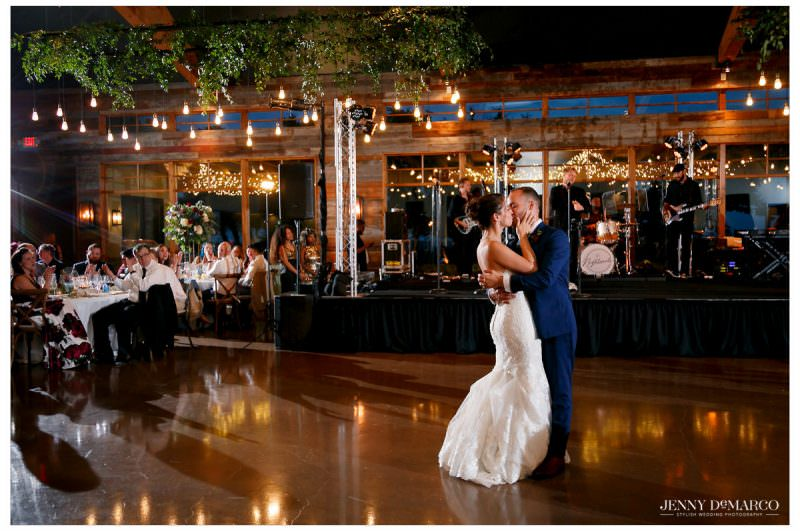 Guests watch as the couple performs their first dance.