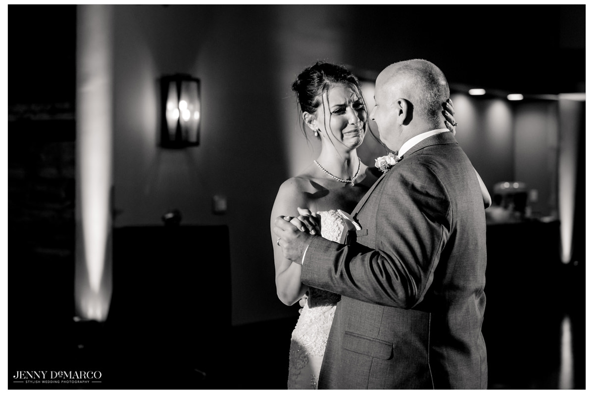 Bride starts to cry as she and her father dance together.