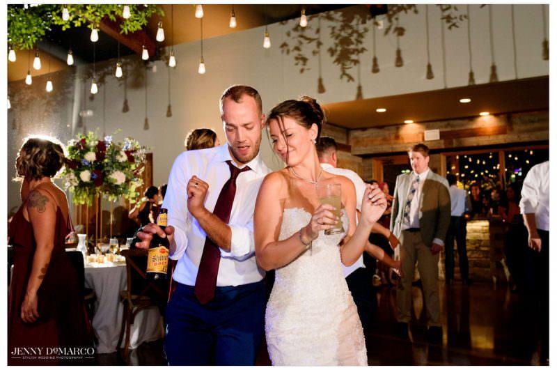 Bride and groom loosen up on the dance floor.