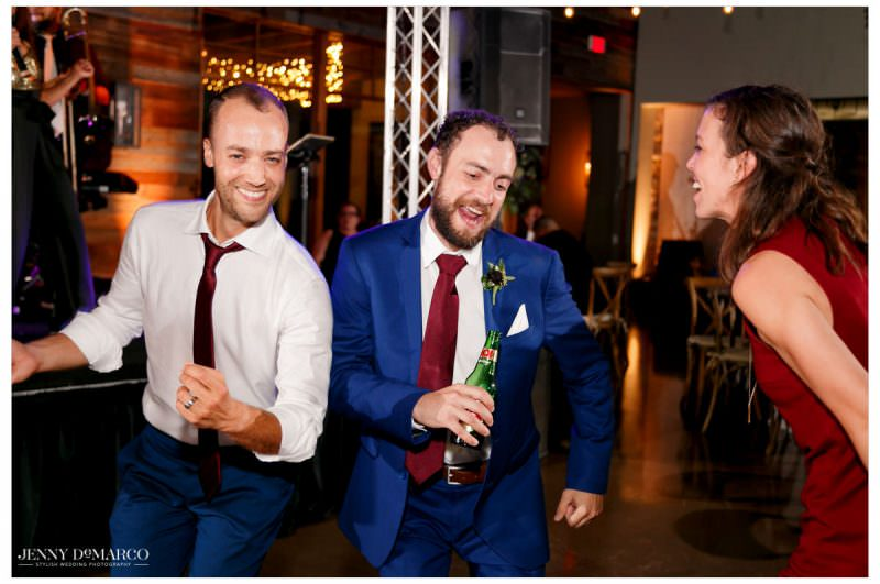 Groom dances with his guests.