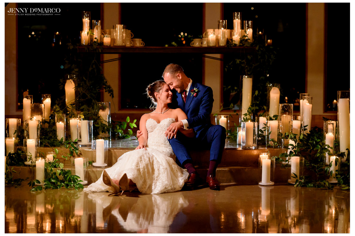 An intimate photo of the couple amidst candles.