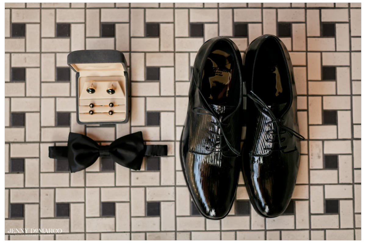 Detail photo of the grooms accessories.