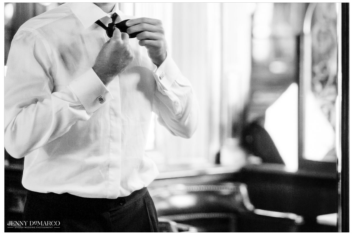 Groom puts on his final touches.