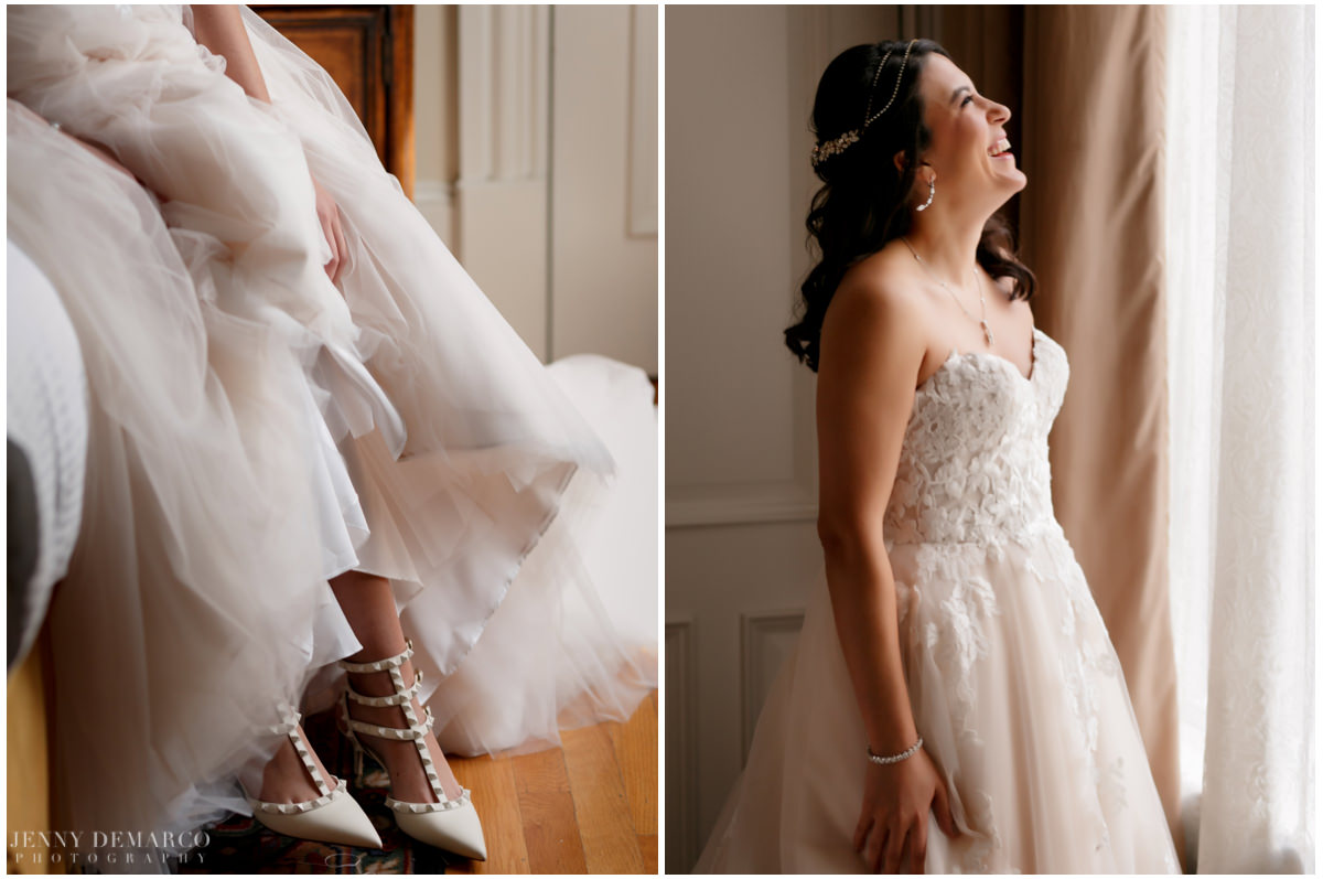 Bride poses in front of a window as her look is complete.