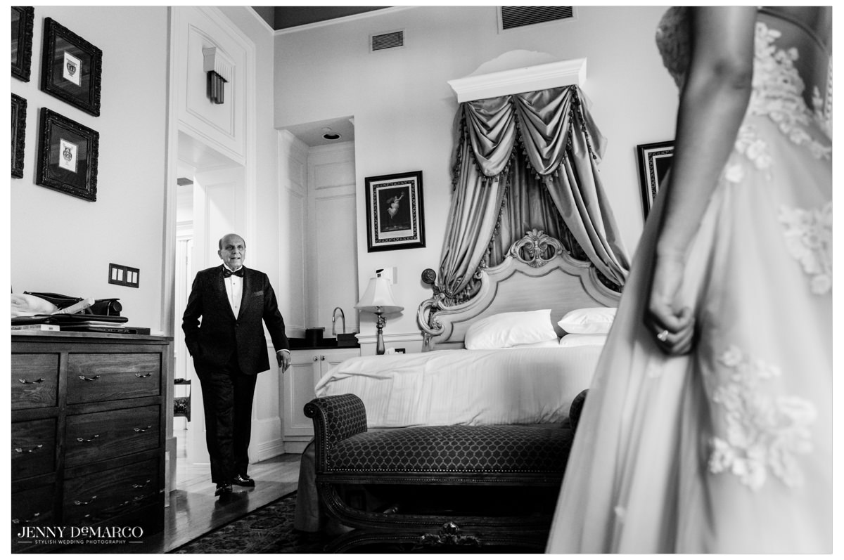The father of the bride walks in to see his daughter.