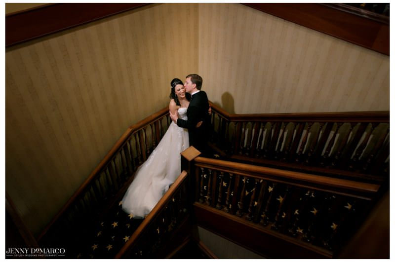 An intimate shot of the couple on a stairwell.