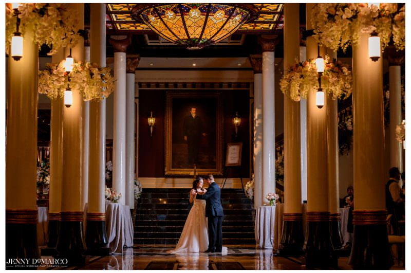 The couple dances together in the Driskill lobby.