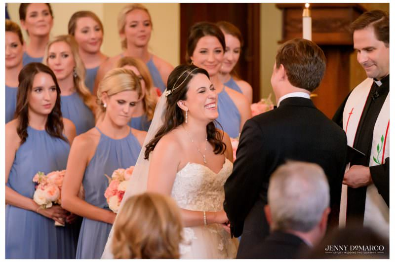 The bride smiles and laughs as she is hand in hand with her fiancé.