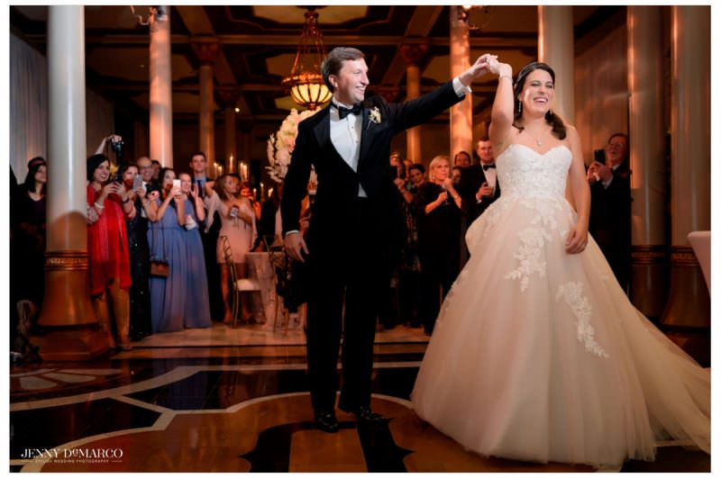 The couple shares their first dance together.