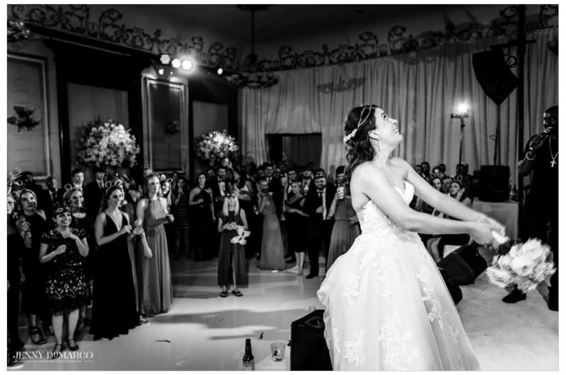 Bride throws her bouquet towards her girls.