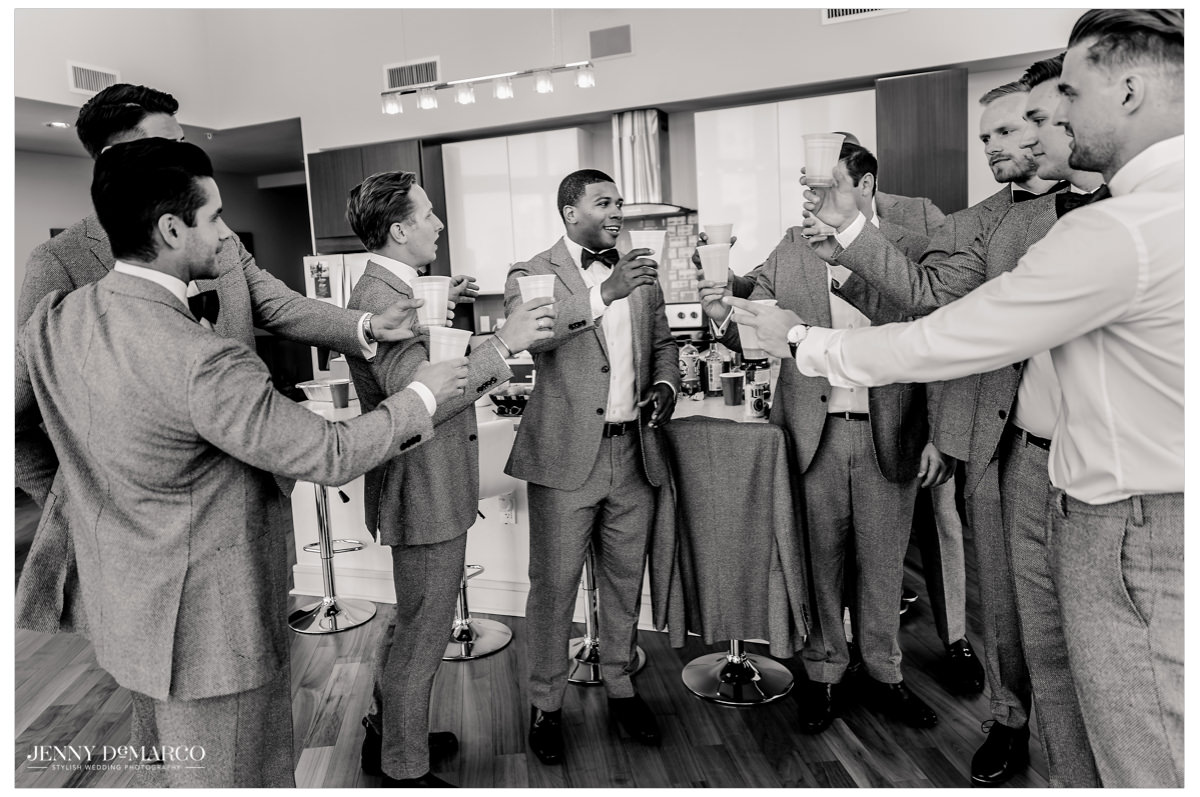 Groomsmen cheers to the big day.
