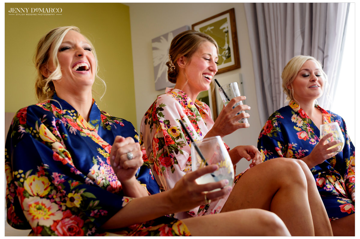 Bridesmaids laugh with their bride.