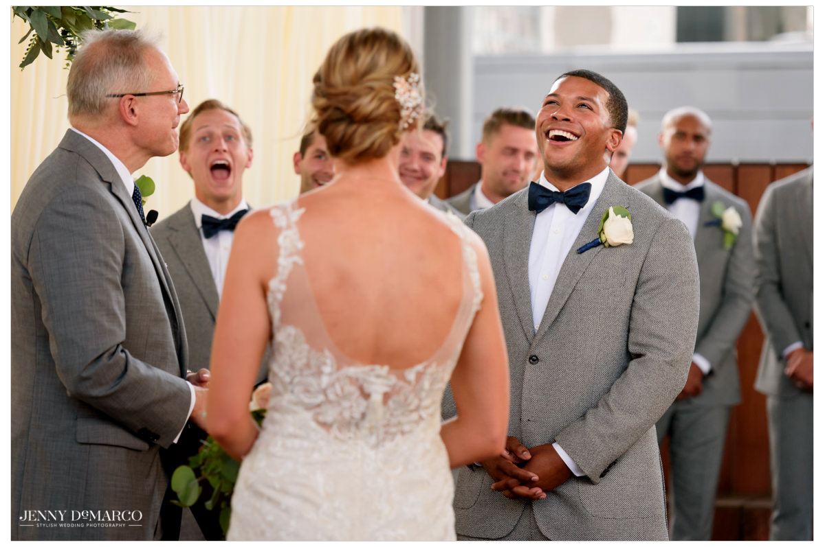 Groom gives a big laugh during the ceremony.