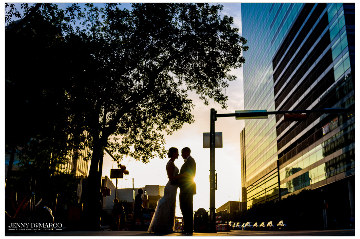 A silhouette shot of the couple downtown.