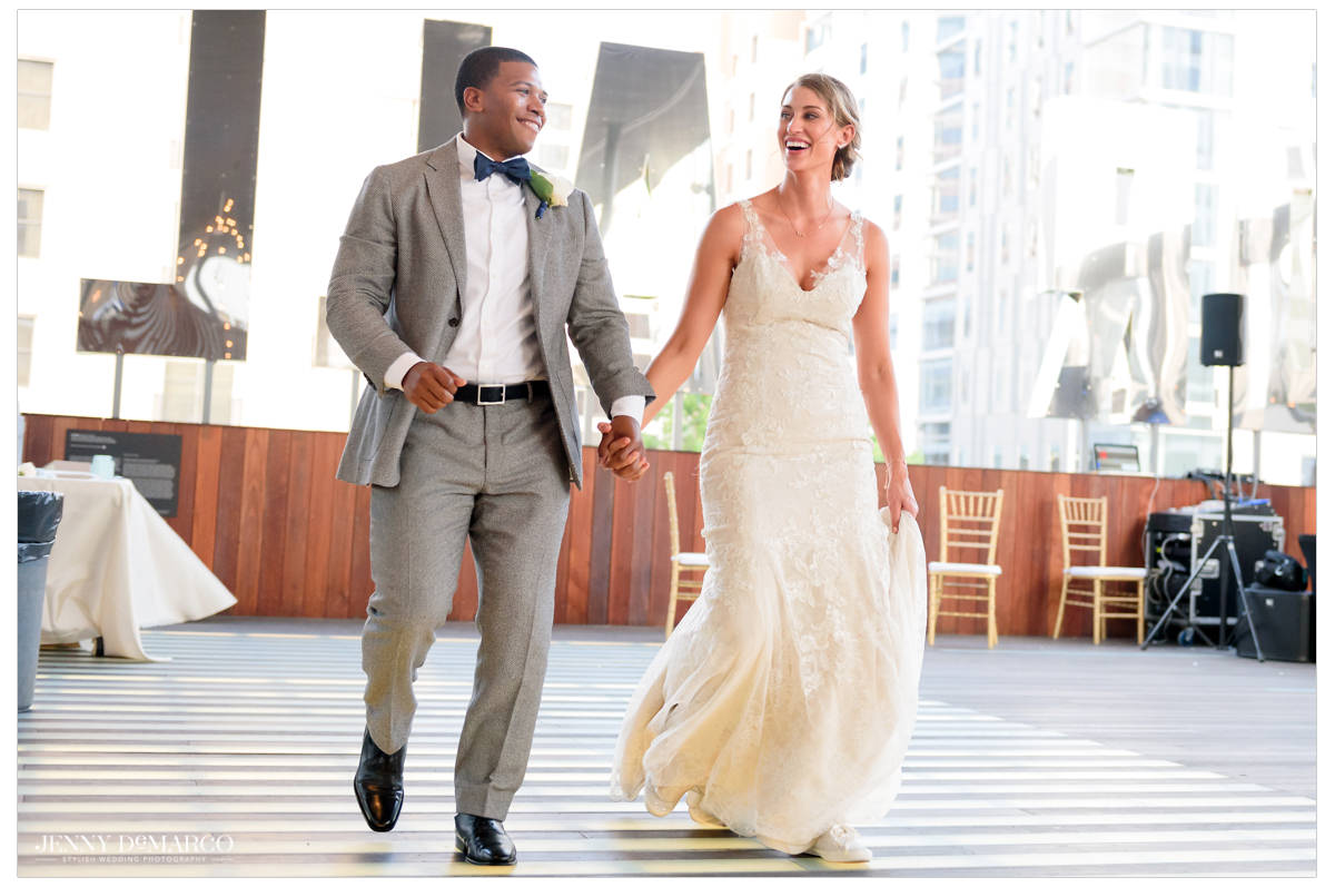 Bride and groom walk into the reception.