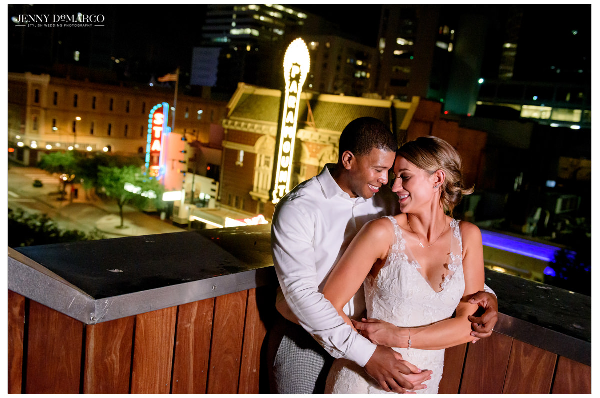 An intimate shot of the bride and groom with the Austin skyline.