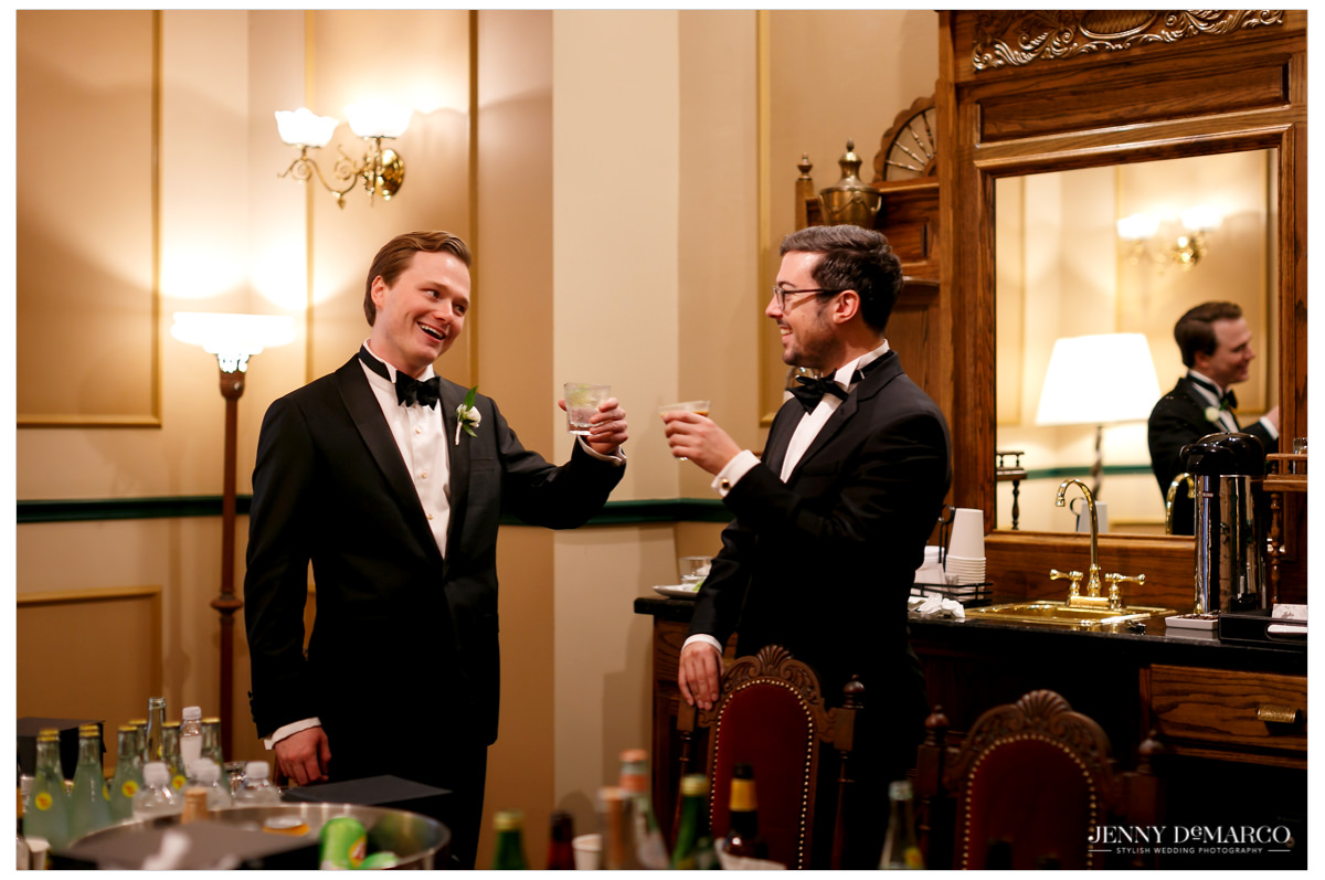 Groom shares a drink with one of his groomsmen.