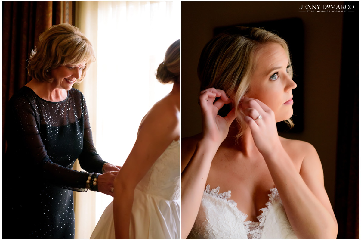 Bride outs on her final touches as her mom helps her into her dress.