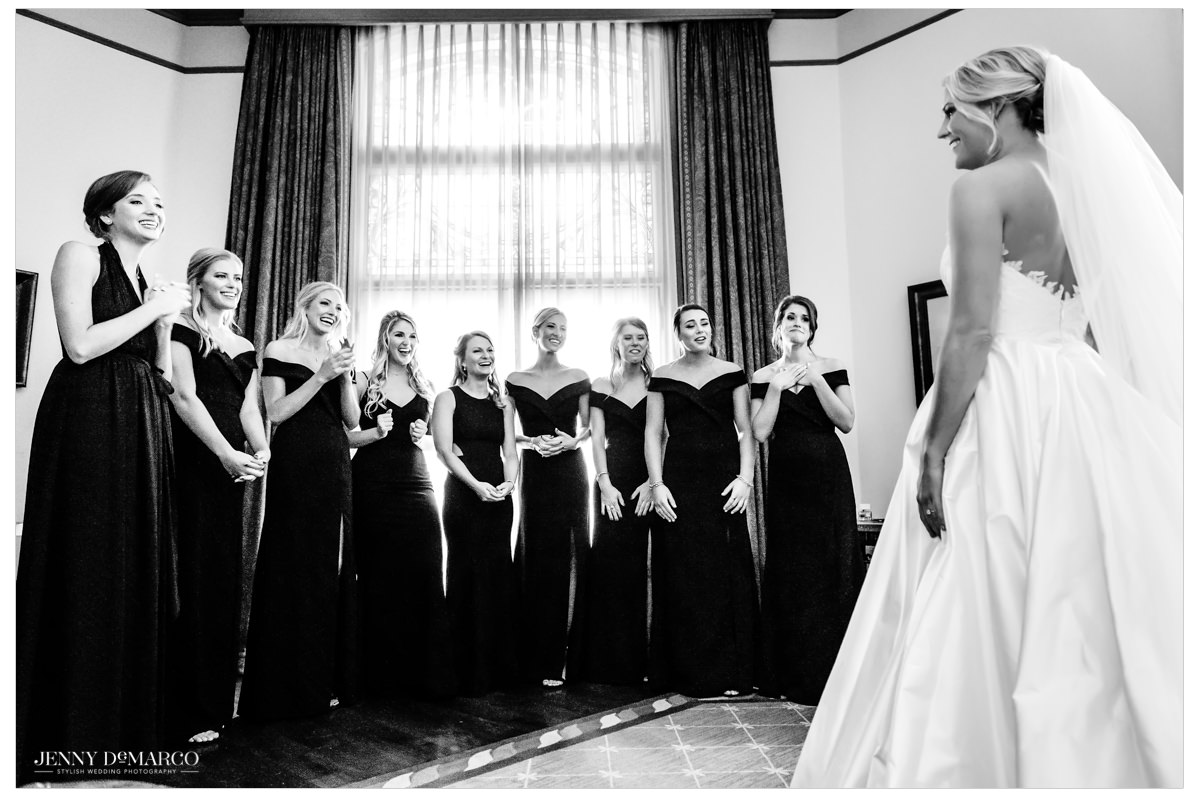 Bride shows off her final look to her wedding party.