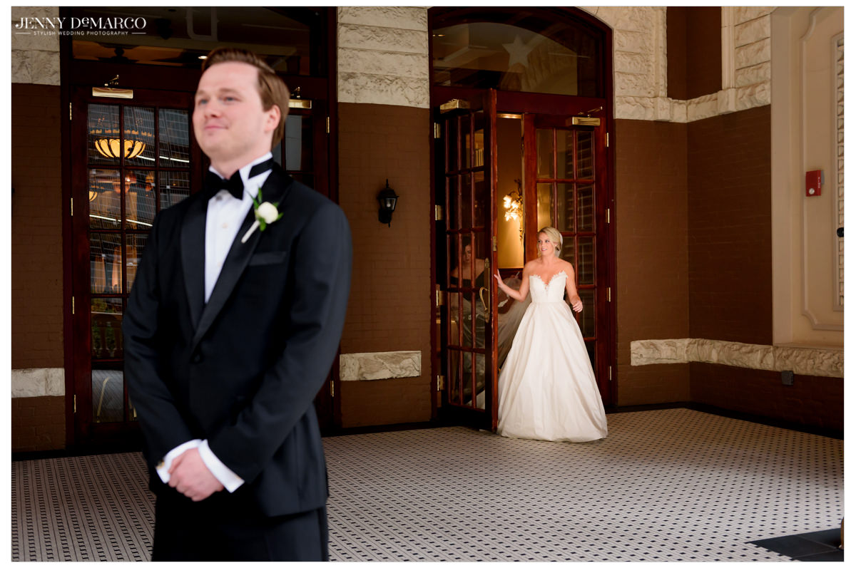 Bride sneaks up behind her husband for the first look.