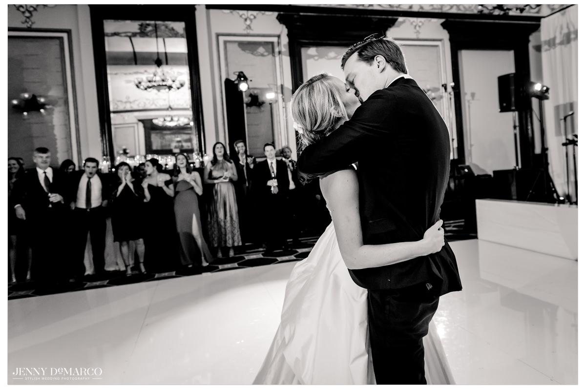 The couple kisses on the dance floor.