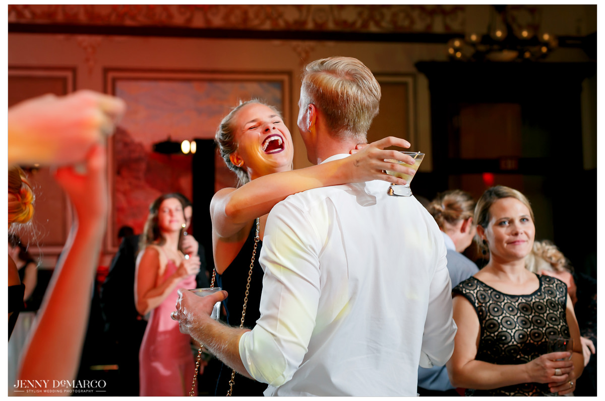 A couple dances together at the reception.