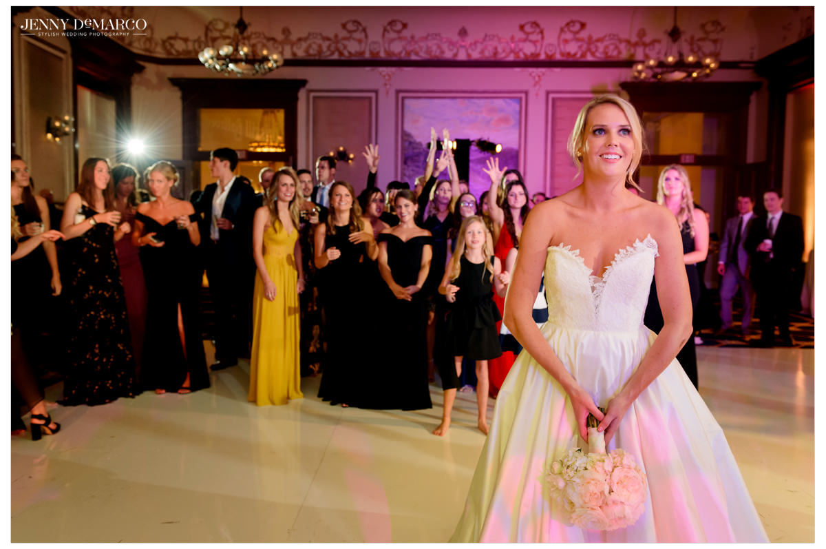 Bride gets ready to toss her bouquet.