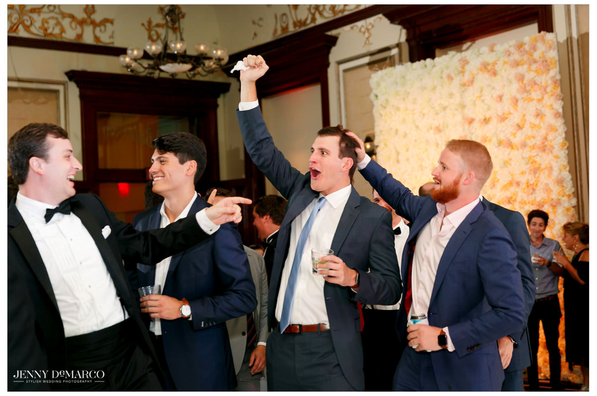 A man looks excited has he catches the garter.