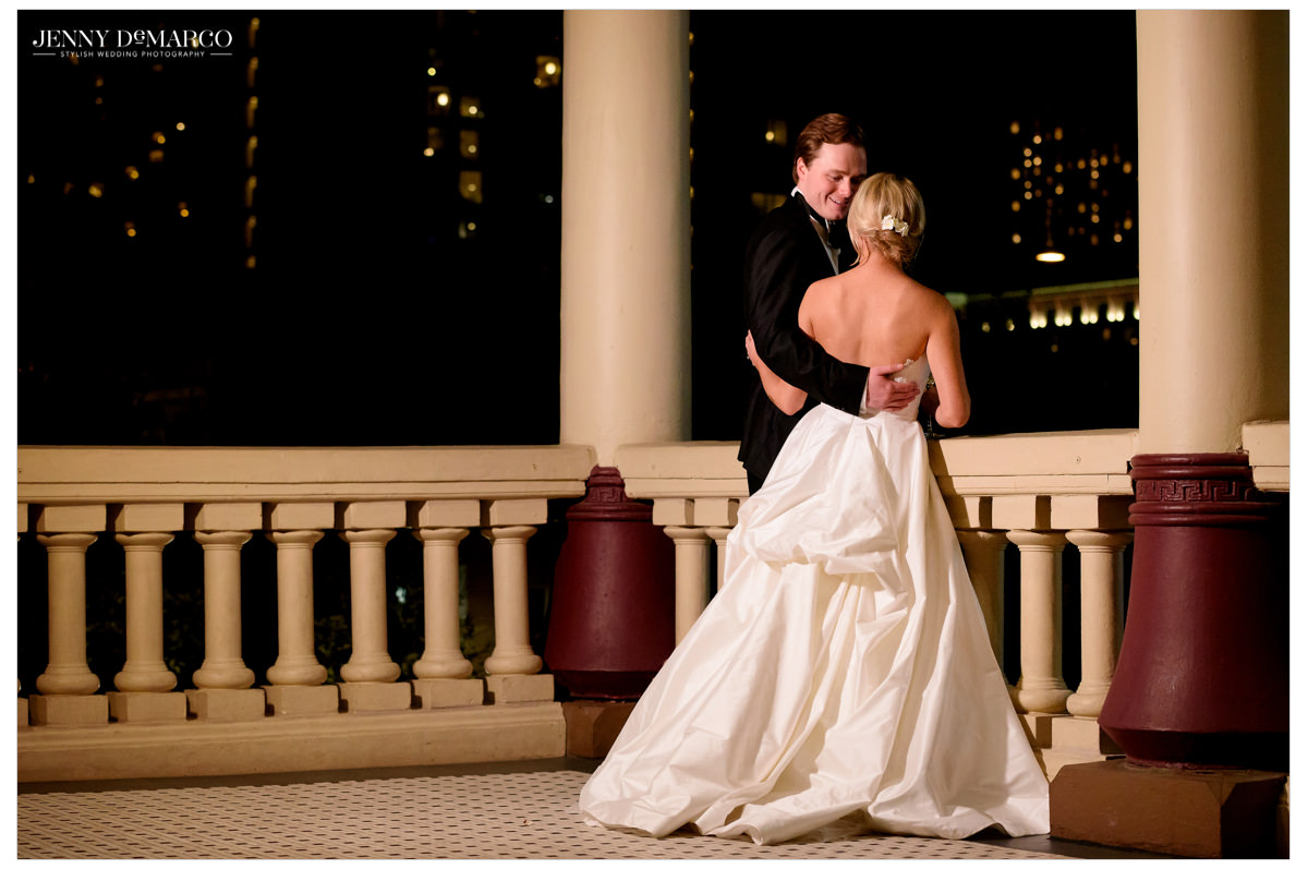 An intimate shot of the bride and groom on the balcony.