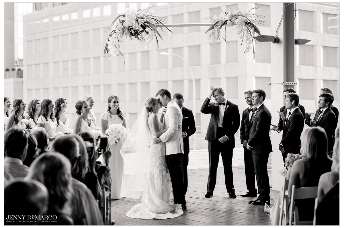 The couple shares their first kiss as newly weds.