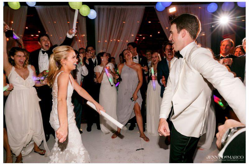 The couple dances as guest surround them.